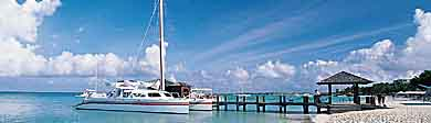 Frommers: A World of Travel Experience: Small sailboat on Aruba shore