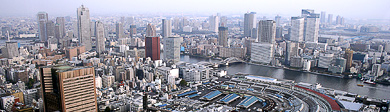 Frommers: A World of Travel Experience: Tokyo skyline, with Tskiji market in the low-rise, blue-roofed buildings