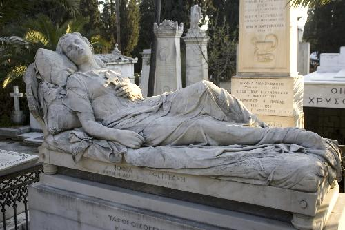 Reclining female statue in Athens cemetary