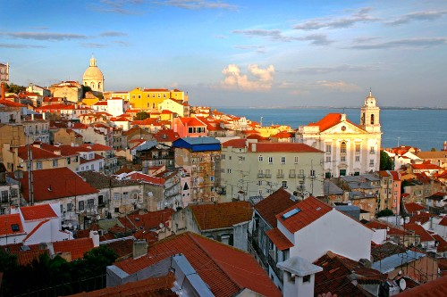 Late afternoon light falling on a Lisbon, Portugal, skyline.