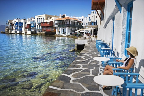 Outdoor cafe in Mykonos, Greece. Photo: Courtesy of Gutsy Women Travel