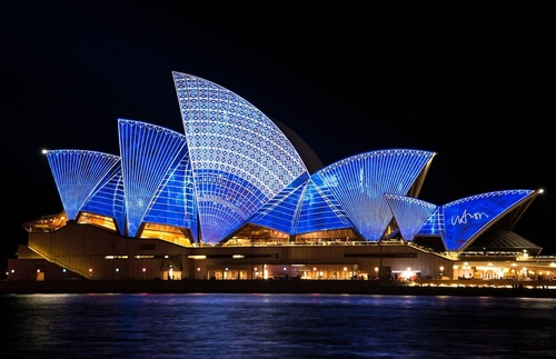 The Sydney Opera House lit up at night