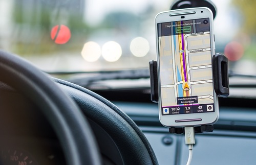 Smartphone being used to navigate driving of car