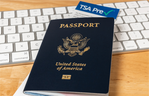 U.S. passport, keyboard, TSA PreCheck form
