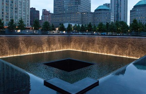 A reflecting pool and waterfall in the footprint of one of the Twin Towers at Memorial Plaza in Manhattan