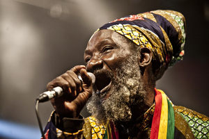A reggae singer belts out a song