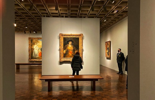 A Rembrandt greets visitors to a gallery on the second floor of the Frick Madison