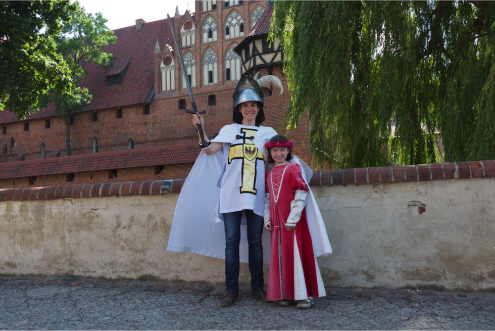 Malborg Castle, outside of Gdansk, Poland, is the largest brick castle in the world. Here, the author and her daughter dress up as medieval residents of the castle