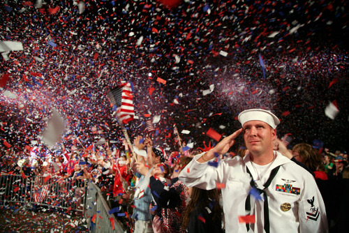 A Navy man salutes at a Fourth of July celebration in Boston