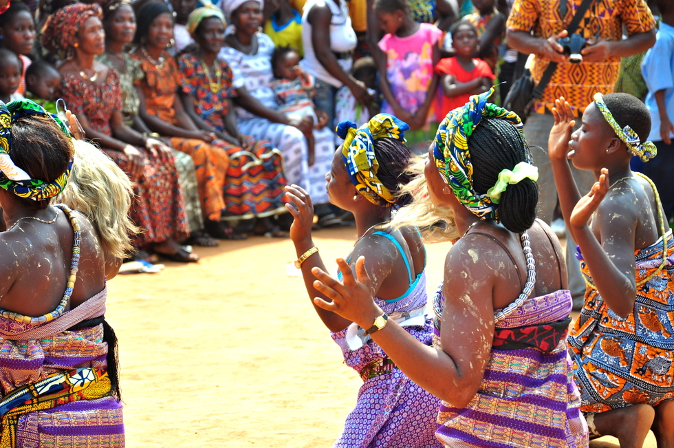 Women in Ghana perform a traditional dance