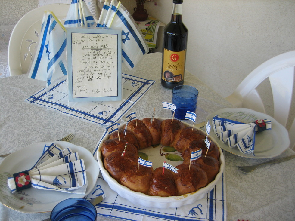 An Israeli holiday table, complete with twelve tribes challah