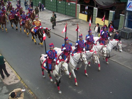 Peruvian horsemen parade during an Indendence Day celebration in Lima