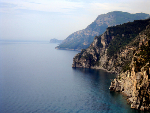 Rock cliffs and the Mediterranean sea along the Amalfi Coast of Italy.
