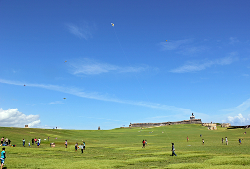 Locals enjoy a breezy Saturday morning by flying kites at El Morro Park.