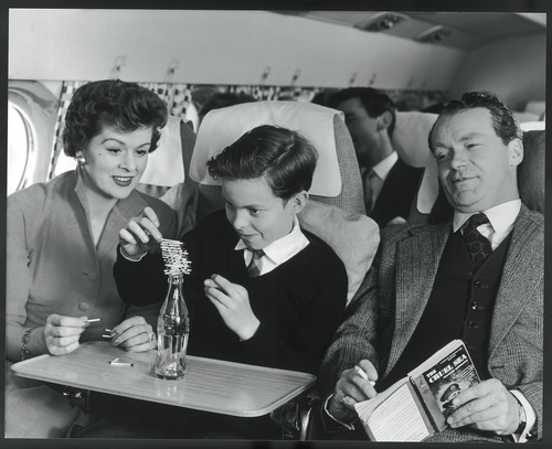 Proud parents look on as their son demonstrates smooth flying on board the jet-propelled de Havilland Comet IV, 1958.