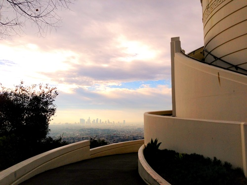 The sun sets on downtown Los Angeles and the Griffith Observatory