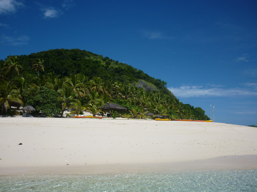 White beaches leading up to tropical forest.