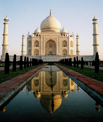 The Taj Mahal reflecting in a long pool, Agra, India