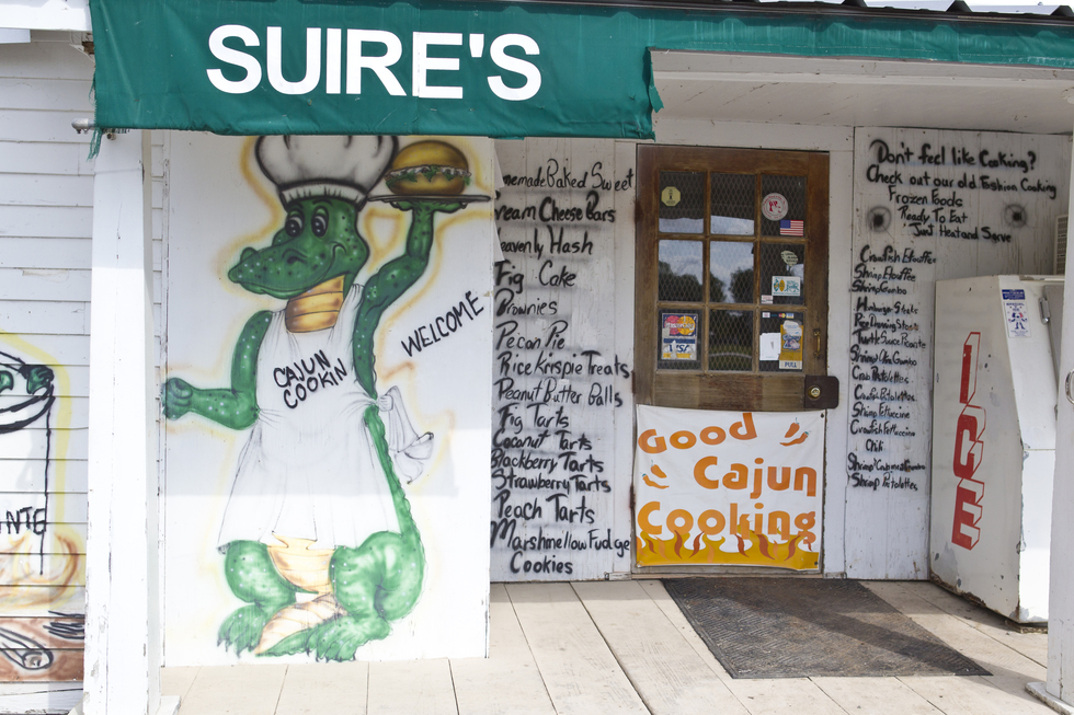The menu is written next to the door of Suires Grocery and Restaurant