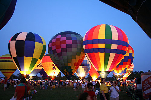 """Balloon glow"" of illuminated hot air balloons at Louisiana Hot Air Balloon Championship Festival, Gonzales, Louisiana"