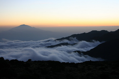 A view from Mount Kilimanjaro in Tanzania looking out towards Mount Meru at sunset