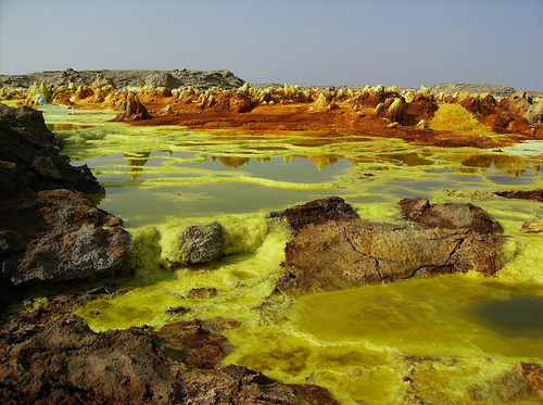 Bright lime-colored springs and crystals cover an area around the Dallol volcano
