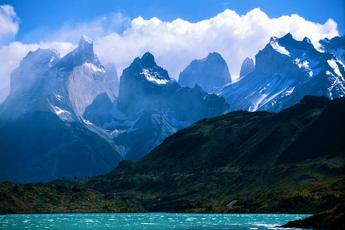 The towering mountains of Torres del Paine, pictured over a dazzling blue lake