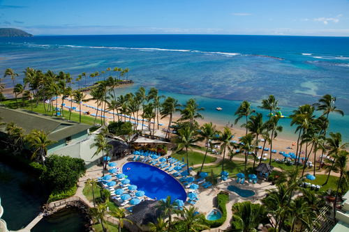 The pool and beach area of the Kahala Hotel and Resort