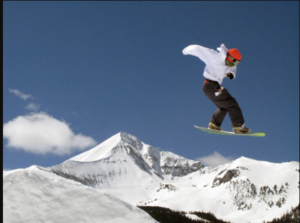A snowboarder challenges himself at Big Sky Resort. Montana