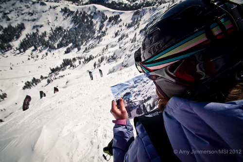 A snowboarder prepares to challenge a steep slope at Kirkwood snow park.