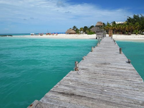 A pier juts from the beach at Isla Mujeres