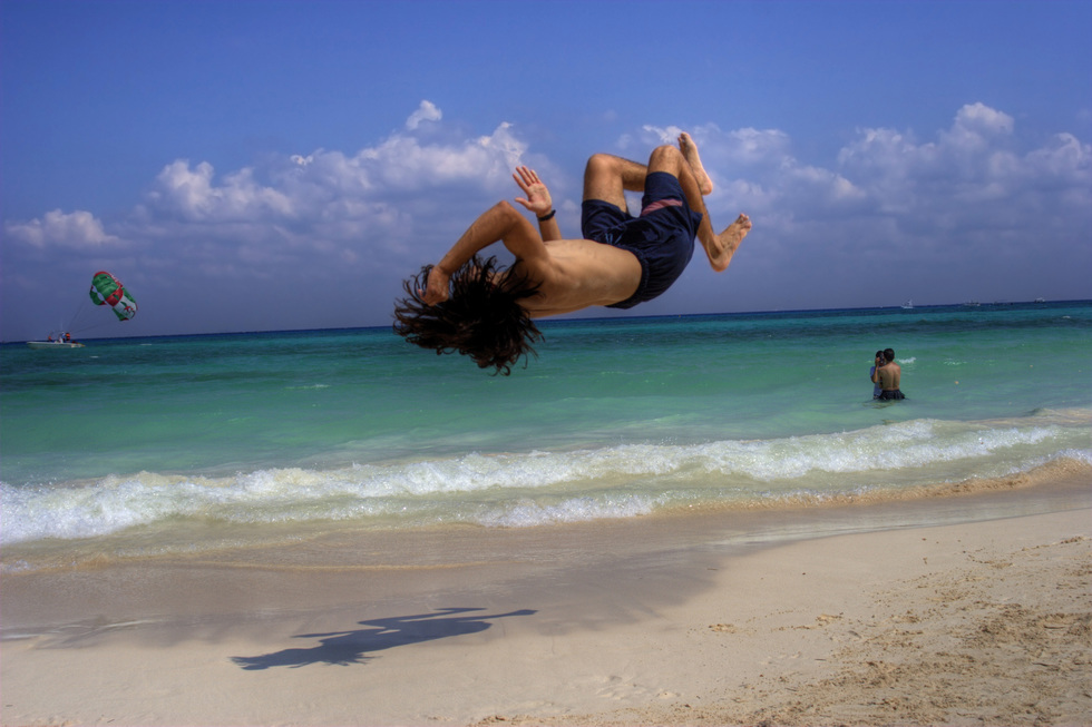 A vacationer flips for Playa del Carmen beach