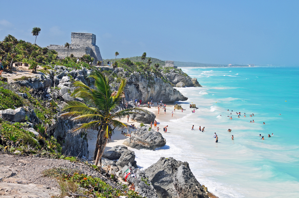 The ruins of Tulum on a cliff overlooking the beach