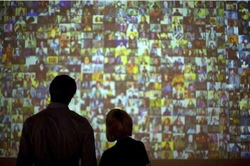 Guests look at a video installation at the Plains Art Museum in Fargo, North Dakota