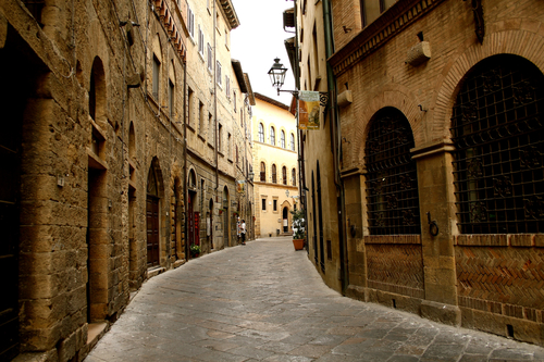Winding view of cobblestone street in Volterra