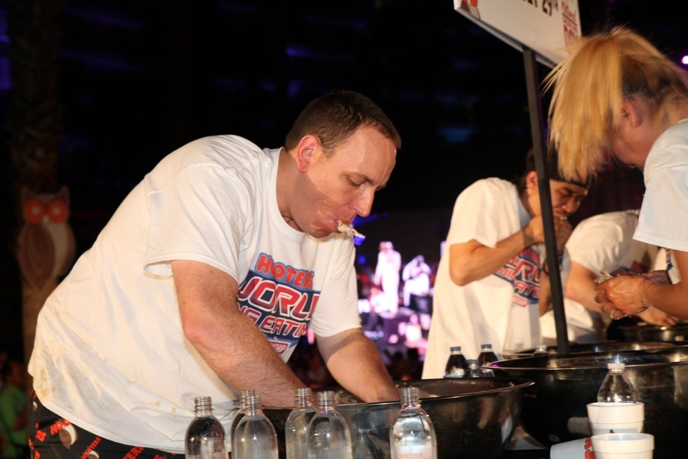 Joey Chestnut eats wings at the Hooters Worldwide Wing Eating Championship.