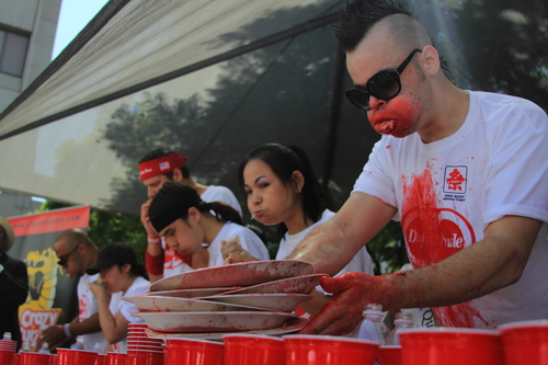 Pat Bertoletti and others eat gyoza messily at the Day-Lee Foods World Gyoza Eating Championship