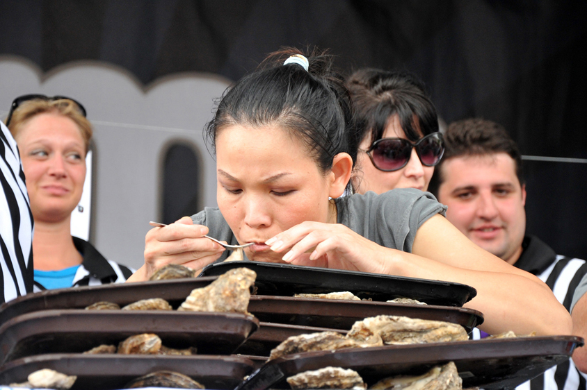 Sonya Thomas slurps up oysters at the Acme Oyster Eating World Championship.