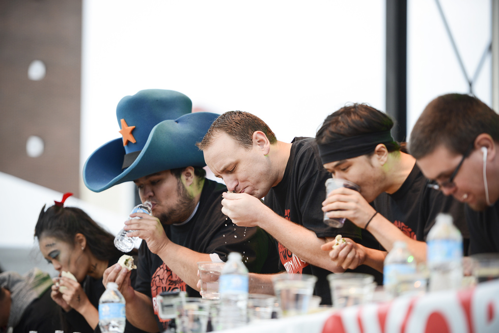 Competitors eat pork brain tacos at the World Brain Eating Competition at Zombie Pub Crawl.