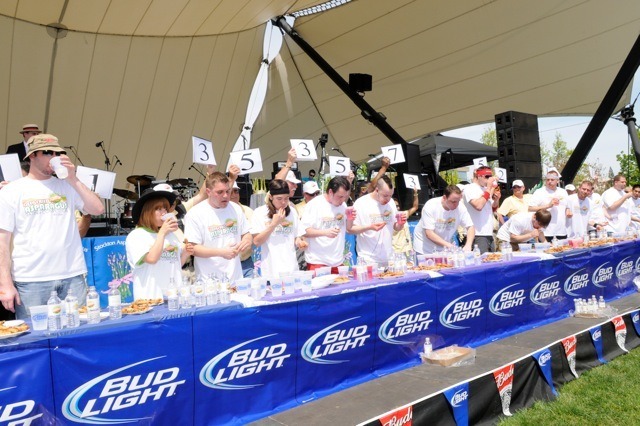 Competitors eat fried asparagus at the Deep-Fried Asparagus Eating Competition