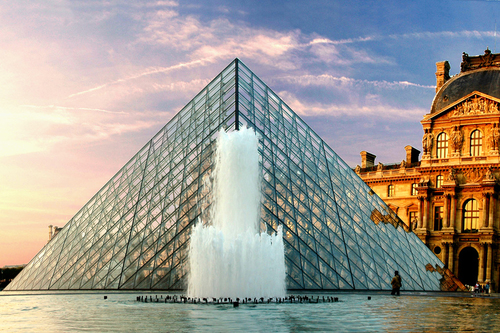 The Louvre behind a fountain in Paris, France.