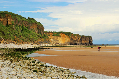 The D-Day beach, Omaha Beach, with cliffs in the background in Normandy, France.