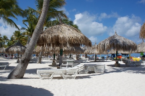 Palapas on the sands of Palm Beach in Aruba.