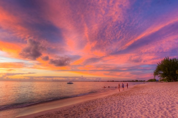 A sunset view of Seven Mile Beach in Grand Cayman.