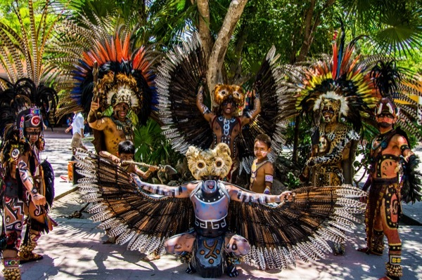 Entertainers dance for tourists at the port of Cozumel.