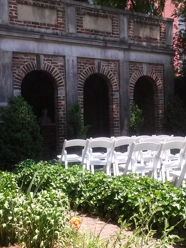 The Edgar Allan Poe Museum garden with lawn chairs set out for events.