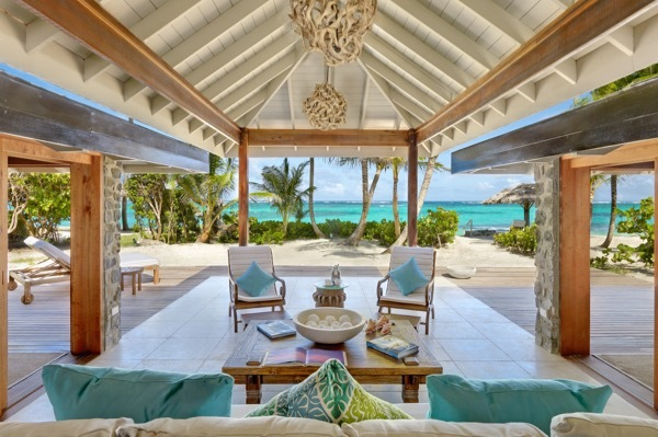 The veranda/living rooms of the Petit St. Vincent resort are open to views of the ocean.