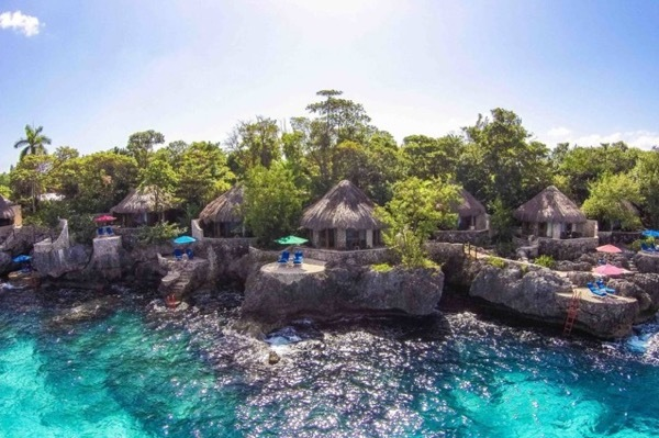 The villas of Rockhouse in Negril, Jamaica are built right to the sea cliff's edge.