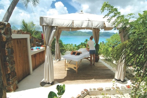 A man gets an outdoor massage on Guana Island