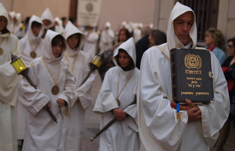 White robed congregation members get ready to take part in a Holy Week procession in Zamora, Spain.